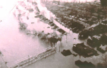 Looking southeast at flooded homes along Front Street, next to the Wellington Road bridge over the South Thames (London, April 1937)