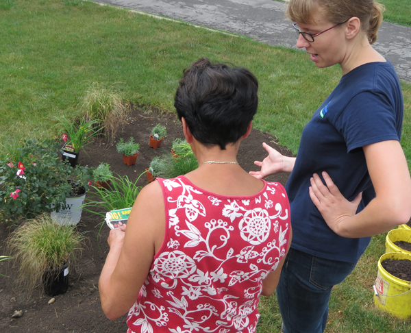 UTRCA staff and home owner with new rain garden
