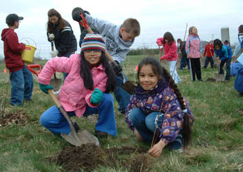 Students plant trees in the Oxbow watershed