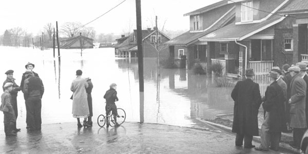 Flooded streets and homes along Springbank Drive during the April 1937 flood